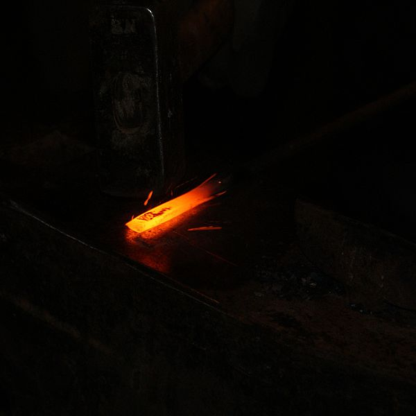 600px-Red_hot_iron_is_forged_with_hammer_and_anvil